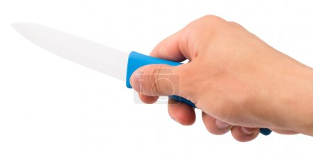 Knife ceramic in a hand of