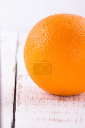 Chpely orange on a table