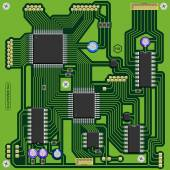 Green printed circuit board (PCB) with components