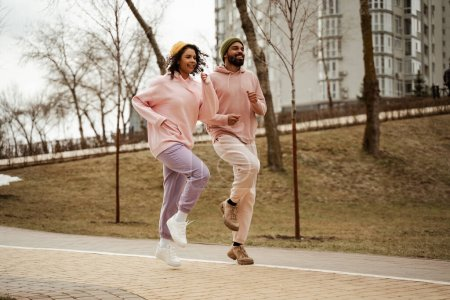 young african american athletes in sportswear running on place outdoors