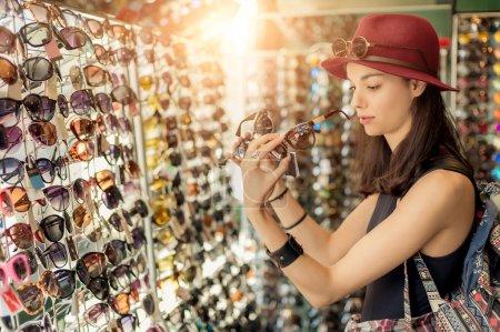 Woman buying sunglasses