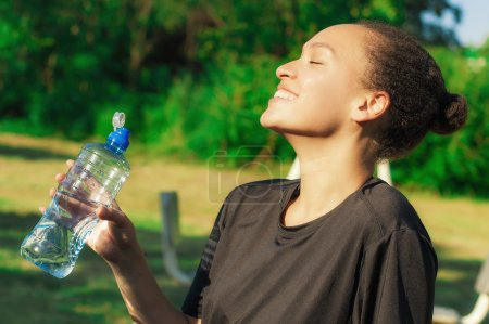 Woman drink water after exercise