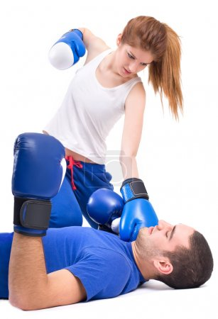 Photo for Boxing knockout. Girl knocked out man - Royalty Free Image