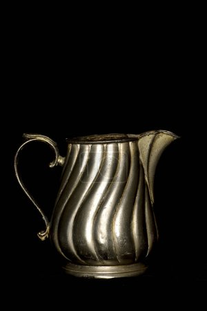 Antique metal jar
