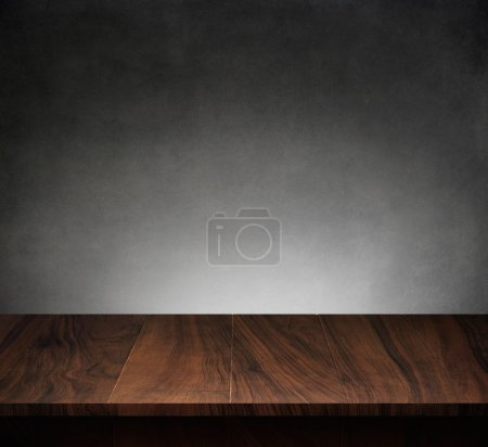 Photo for Wood table with dark concrete texture background - Royalty Free Image