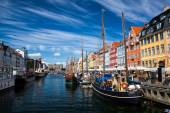Nyhavn, blue sky and river, in Copenhagen, Denmark.