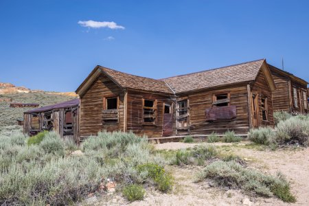 Photo for Bodie Ghost Town in California, USA. Bodie is a ghost town in the Bodie Hills east of the Sierra Nevada mountain range in Mono County. The ghost town officially became Bodie State Historic Park in 1962, and receives about 200,000 visitors yearly. - Royalty Free Image
