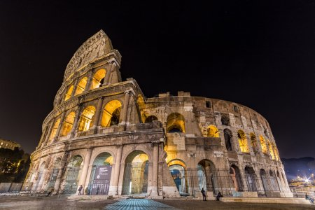 Photo for Colosseum at night in Rome, Italy.  The Coliseum is one of Rome's most popular tourist attractions with over 5 million visitors per year. - Royalty Free Image