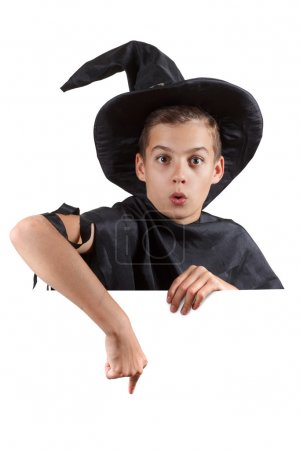 Teen boy in carnival costume wizard. Isolated on white