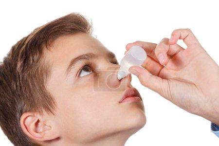 Boy drips medical nose drops