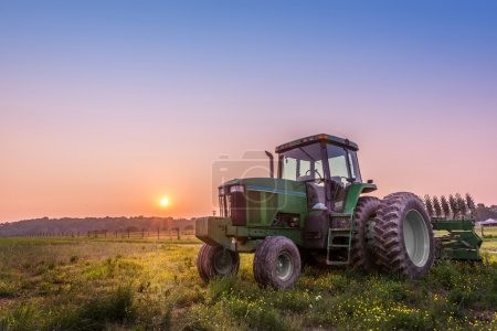 Photo for Farm Tractor in a field on a Maryland Farm at sunset - Royalty Free Image