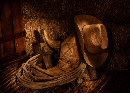 Photo for Cowboy Boots, Cowboy Hat, and Lariat in front of Hay Bale / Boots and Hay - Royalty Free Image