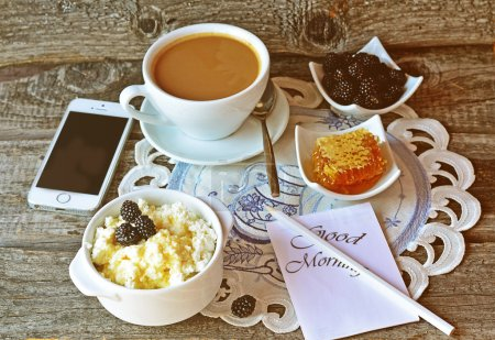 Cottage cheese with honey and blackberry and cup of coffee on the vintage napkin on the white wooden background, breakfast.  Toned pictured, selective focus
