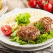 Pork chops cutlets with potato and vegetable...
