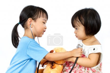 Asian Little Chinese Girls Playing as Doctor and Patient with St