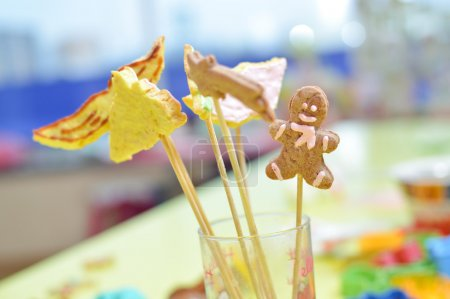 Picture of handmade cookies on stick in glass