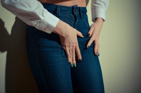 pretty female shape with hands on hips wearing jeans
