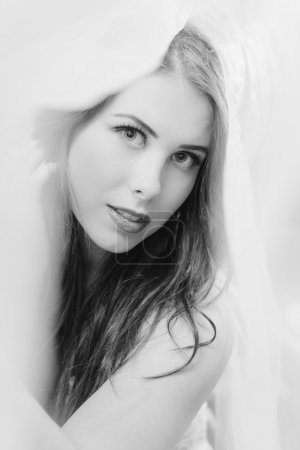 Black and white of beautiful young lady sensually looking at camera, close up portrait