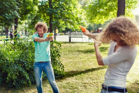 Friends playing with water gun