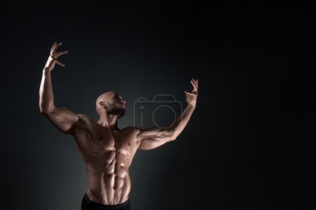 Man posing in the studio on a dark background