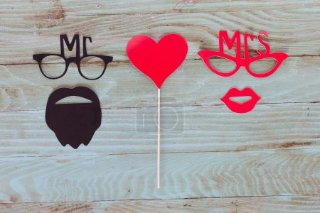 Paper people together in love on the  wooden background