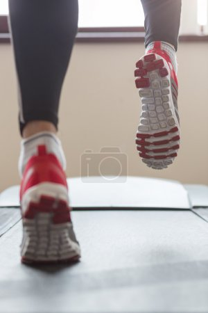 Photo for Man running in a gym on a treadmill concept for exercising, fitness and healthy lifestyle - Royalty Free Image