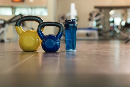 Family sport or weight loss concept. Dumbbells, towel and shaker