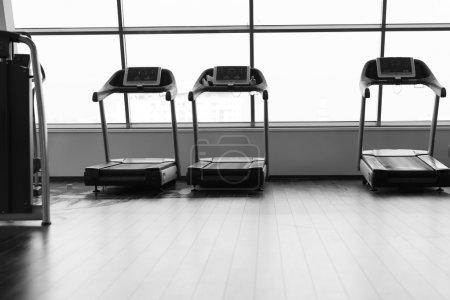 running in a gym on a treadmill concept for exercising, fitness