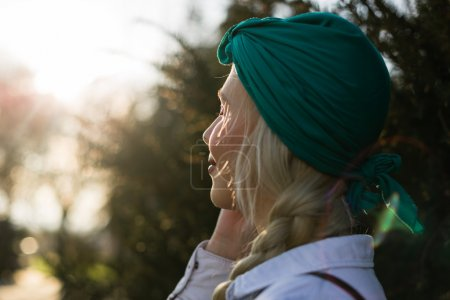 Happy female traveler with turban talking on mobile phone about