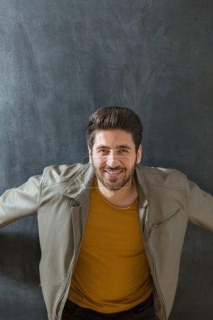 Portrait of a bearded man on chalkboard background