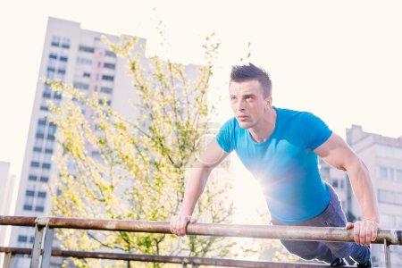 Street workout, confident sportsman
