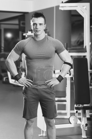Photo for Portrait of muscular man with arms crossed in crossfit gym - Royalty Free Image