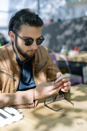 Smart businessman checking time in creative office
