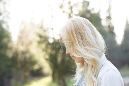Beautiful teenage girl in beige hat and sweater taking a selfie