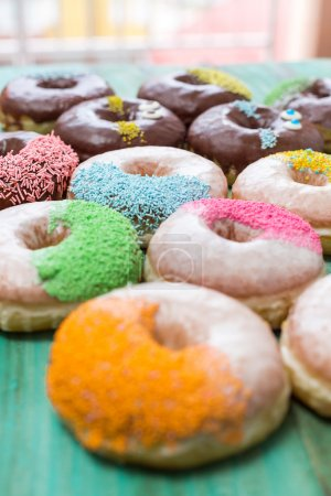Photo for Chocolate glazed donuts and sprinkle donuts. - Royalty Free Image