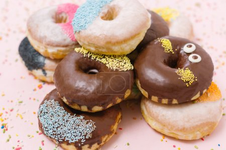 Photo for Chocolate glazed donuts and sprinkle donuts  background - Royalty Free Image