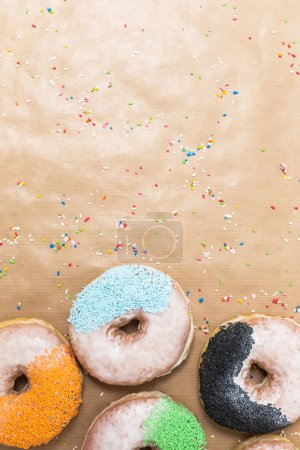 Colorful donuts on  kraft paper