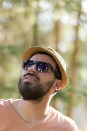 Handsome bearded wearing hat and sunglasses