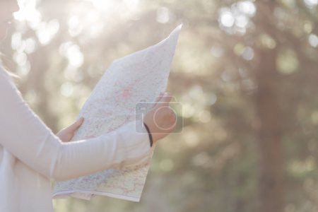 Female explorer looking at a map outdoor