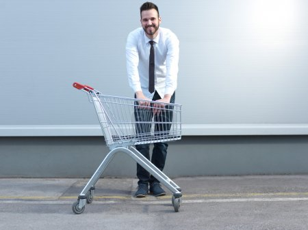 Businessman driving in the shopping cart