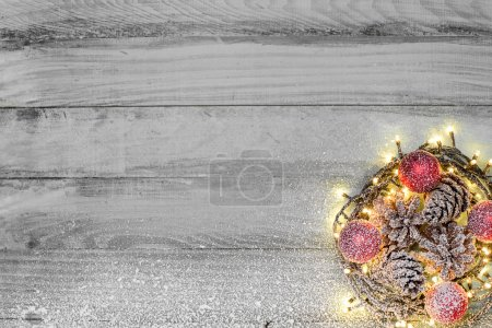 Nest with Christmas balls on rustic background