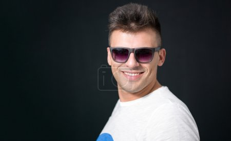 Happy young man. Portrait of handsome young man in casual shirt