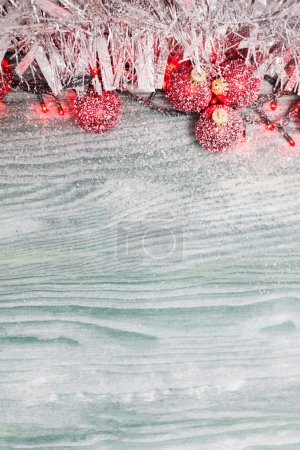 Snowflake Christmas Ornaments with fir greens against Rustic Whi