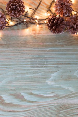 Xmas or new year composition with holiday decoration -on wooden
