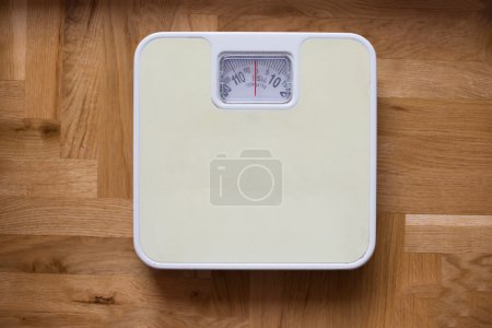 Photo for Bathroom scale - diet and overweight concept - Royalty Free Image