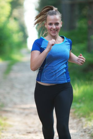 running healthy fitness woman training for marathon outdoors in