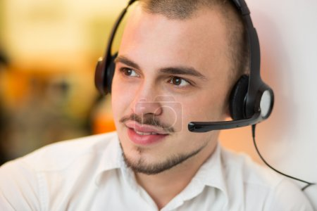 Portrait of happy smiling customer support phone operator in hea