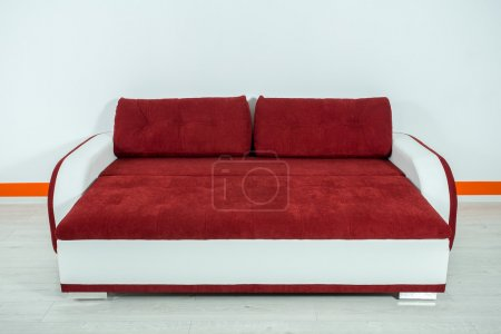 red-white sofa on a white background