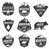 Mountain camp badges templates with mountains and trees isolated