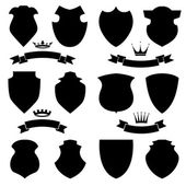Shields crowns  and stylish ribbon set isolated on white background Different black shield shapes collection Heraldic royal design